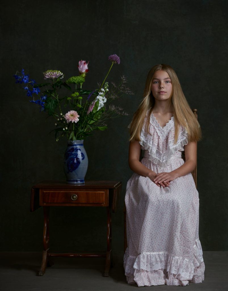 Fine art portrait with vase and girl